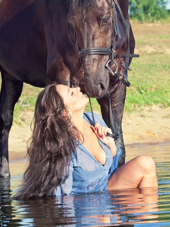 kiss of pretty girl to yours  horse Stock Photo