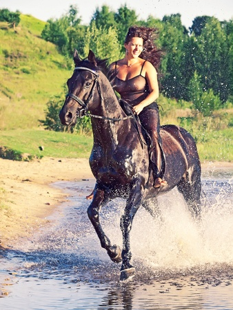 warmblood: galloping pretty women on  horse
