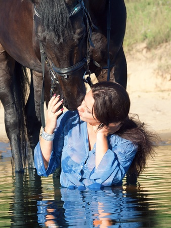 kiss of pretty girl to yours  horse photo