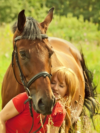 young girl  with her horse photo