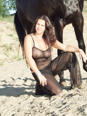 sexy women with black horse photo