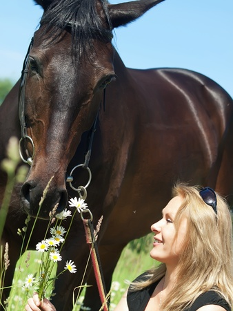 beautiful women with her mare photo