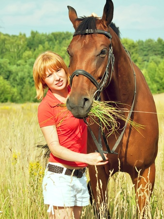 young girl  with her horse Stock Photo - 11618095