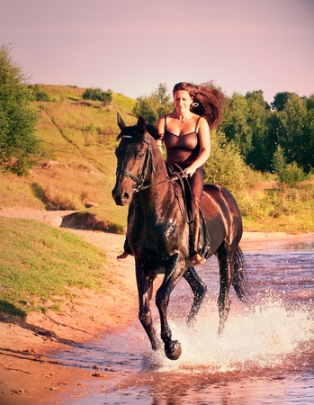 galloping pretty women on  horse  photo
