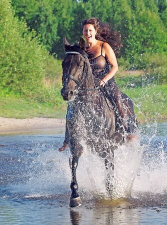 galloping pretty women on  horse  photo