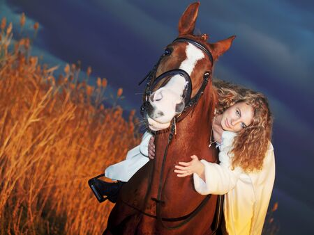 bride ride on red  horse at sunset Stock Photo - 12773942
