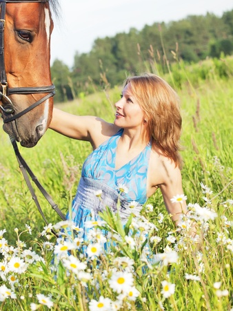 young girl  with her horse outdoor sunny evening photo