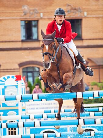 mikhail: SAINT PETERSBURG-JULY 08: Rider Mikhail Safronov on Virones C in the CSI3*-WCSIYH1* International Jumping Grand Prix FEI World Cup Competition 140-160cm on July 08, 2012 in Saint Petersburg, Russia. Editorial