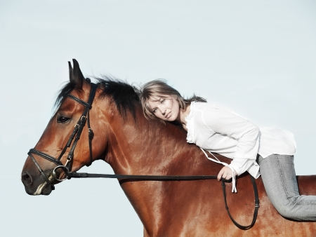 beautiful  girl  riding on horse  sunny evening photo