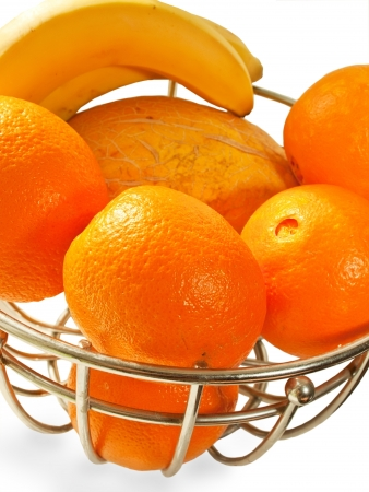 Metal  basket with orange fruits isolated on a white background Stock Photo - 14731905
