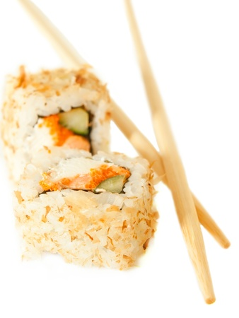 two sushi rolsl with tuna flakes and chopsticks over white photo