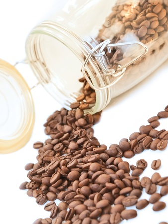 Heap of coffee beans from jar  photo