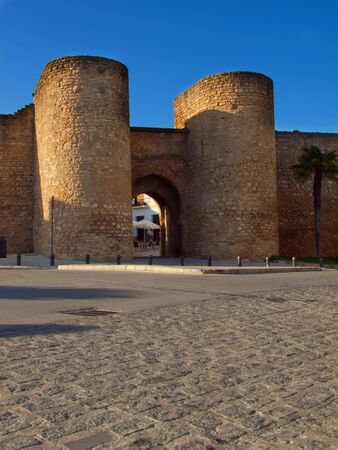 Old city wall with gate in Ronda, Spain photo