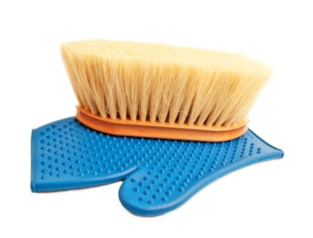 bristle:  rubber mitten, and brush with long bristle for horse isolated