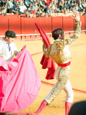 SEVILLA -MAY 20: Novilladas in Plaza de Toros de Sevilla. Novillero: Emilio Huertas and unknown member of corrida. May 20, 2012 in Sevilla (Spain)  Stock Photo - 16972883