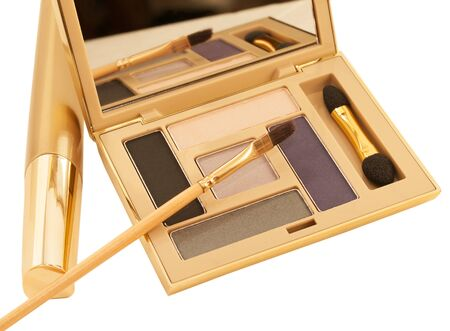 luxe: luxe purple and beige make-up eyeshadows in gold packing