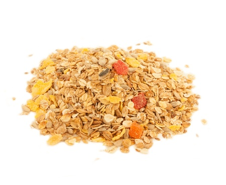 A close up  of delicious healthy muesli with dry bits of pawpaw, pineapple, prunes and raisins Standard-Bild