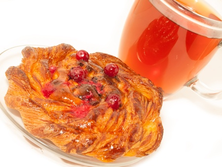 Delicious freshly baked pastry  with cranberries and cup of tea photo