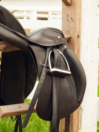 dressage saddle at  the bracket. outdoor  Stock Photo