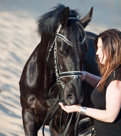 women with black horse. photo