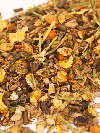 basic care: natural  muesli  with herbs background  for horse  Stock Photo