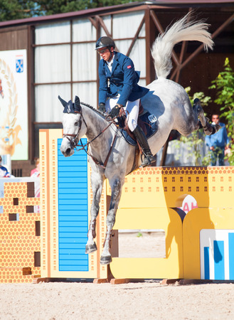 gran prix: SAINT PETERSBURG-JULY 06: Rider Andis Varna on Coradina in the CSI3*-WCSIYH1* International Jumping Grand Prix FEI World Cup Competition 160cm on July 06, 2014 in Saint Petersburg, Russia. Winner of Gran Prix