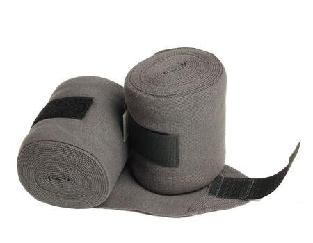 tejidos de punto: vendas nuevas prendas de punto gris de caballos aislados en blanco