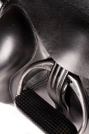 stirrup: stirrup at dressage saddle. close up