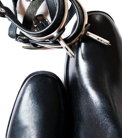 accessories horse: horse riding  dressage boots and spurs isolated on white. close up