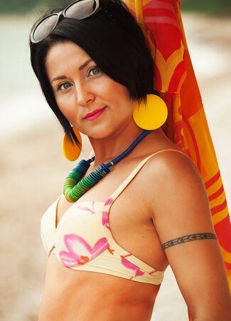 pareo: woman in bikini and pareo at sea background