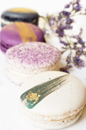 colorful macaroon cakes  against white background