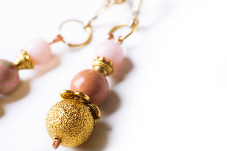 gold earrings with pink semipreciouses. nephritis and variscite