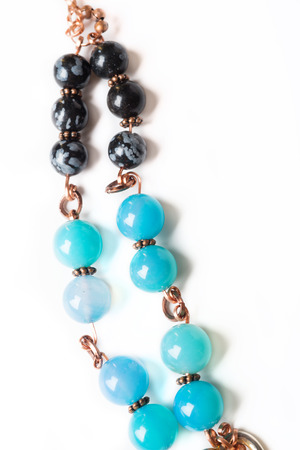 jewerly bracelet  with chalcedony and obsidian around white background
