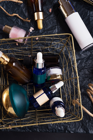 set of nature precious oils and  care cosmetics on black background . Stockfoto