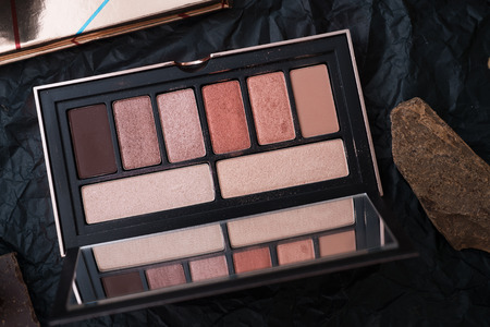set of eye shadow palette  and nature chocolate on black background  in frame . Imagens