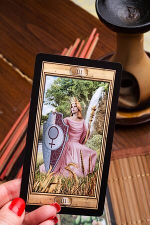 Divination set up at classical universal Tarot. Empress. close up Editorial