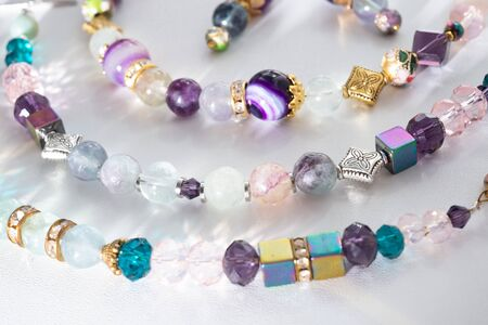 gold jewelry bracelets with semiprecious and crystal at white background