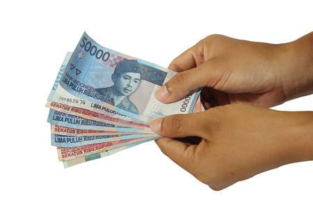 hands giving out money on white background, rupiah money
