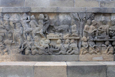 detail of buddhist carved relief in borobudur temple at magelang, Java, Indonesia