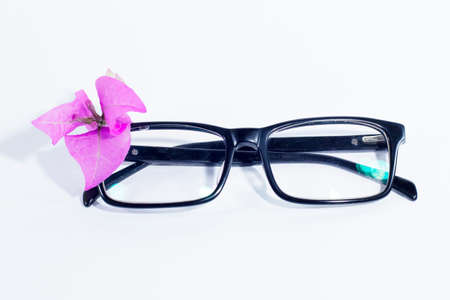 conceptual eyeglasses and bougenville flower isolated on white background
