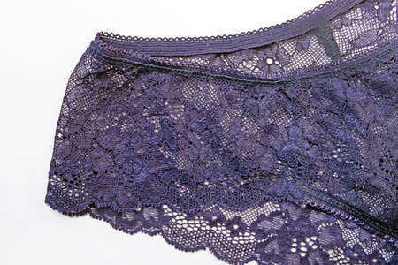 Fragment of purple lace panties on a white background.