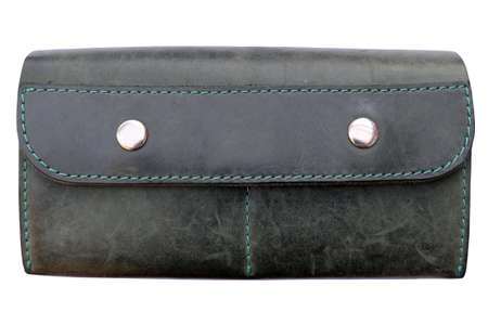 Dark green leather wallet with two metal buttons, isolate. Large womens wallet, small clutch closed.