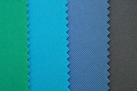 Samples of fabrics in pastel shades. Blue, green, grey piece of fabric with texture. Lightweight fabric made of synthetic fibers (nylon or polyester) of a certain structure with a special coating. Banque d'images