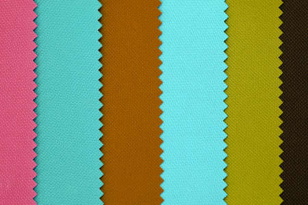 Multi pastel color fabric texture samples. Samples of fabrics of different colors retro style. Polyester texture, pieces of fabric with scarred edges background. Turquoise, brown and pink color