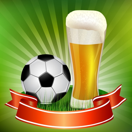 Glass of beer with soccer ball on the grass