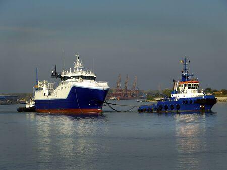 tug boat: Tug Boat and Cargo Ship Stock Photo