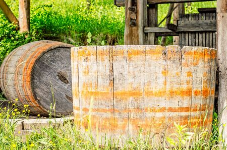 ferment: Old wood barrel used for stomping or crushing grapes. Stock Photo