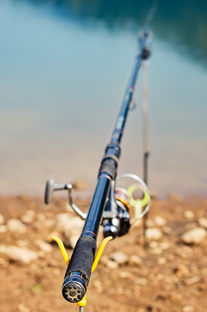 aluminum rod: Fishing rod supported by aluminum and plastic v-shaped pole holders.