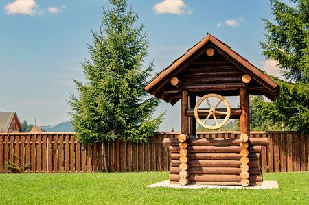 well made: Rustic well house made of wood beams. Stock Photo