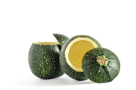 pulp: Couple of eight ball squash with cut top and scooped out pulp isolated on white.